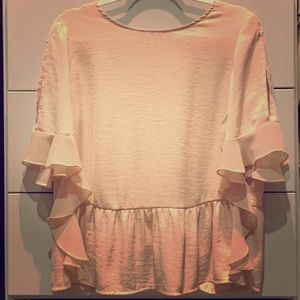 Blush colored blouse with peep-shoulders